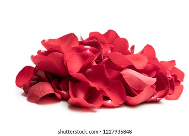 Heap  of red rose petals isolated on white