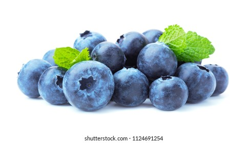 heap of ripe blue blueberry with mint leaves isolated on white background
