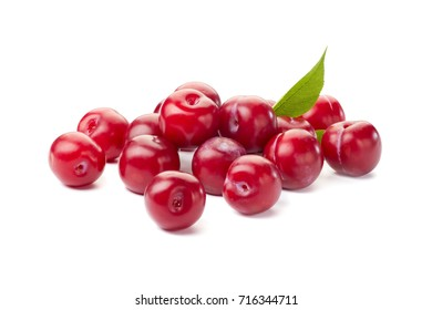 Heap of ripe red plums on white