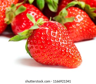 heap of ripe strawberry fruits on white background