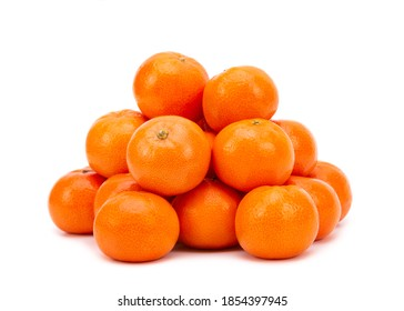 Heap of ripe tangerines on a white background. Tangerines close up. Tangerines isolate on a white background.