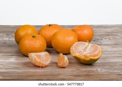heap of ripe tangerines on wooden table