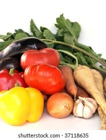 heap of ripe vegetables on white background. pepper, tomato, onion, garlic, parsnip, carrot, eggplant