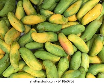 Heap of ripening Thai rainbow mangoes background and texture