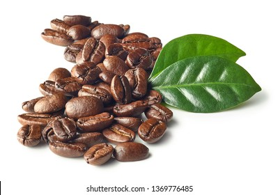 Heap of roasted coffee beans and leaves isolated on white background