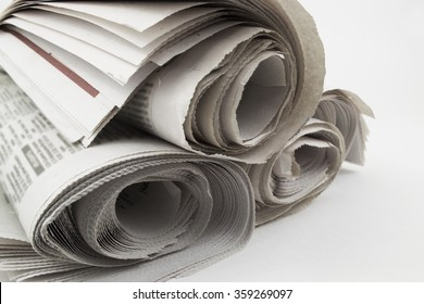 Heap rolls of newspapers