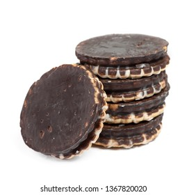 Heap of round chocolate cookies isolated on white background
