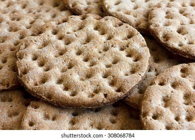 Heap of round rye crispbreads as a background.
