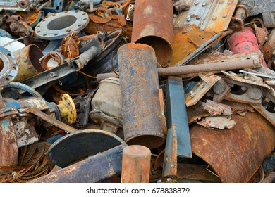A heap of rusty distorted metal. The point of scrap metal reception