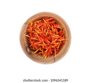 Heap of saffron in wooden bowl isolated on white background. Top view. Flat lay