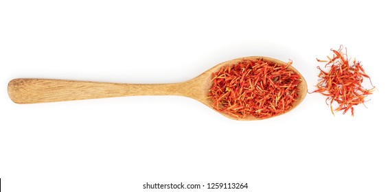 Heap of saffron in wooden spoon isolated on white background. Top view. Flat lay
