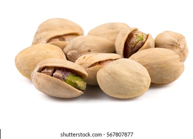 Heap of salted pistachio nuts isolated on a white background