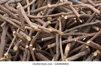 Heap of scattered licorice roots. Food background