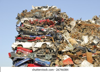 A heap of scrap Cars waiting to be shipped for recycling.