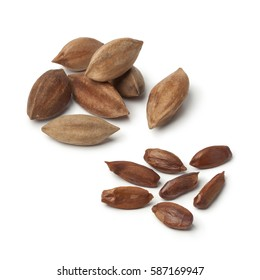Heap of shelled and unshelled pili nuts from the Philippines on white background