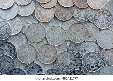 A heap of silver Riyal coins of the Makkah Mint.