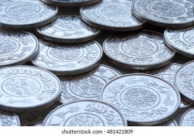A heap of silver Riyal coins of the Makkah Mint.