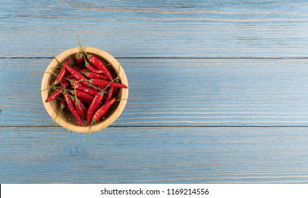Heap of Small Very Hot Chili Peppers in Wooden Bowl Isolated on White Background. Red Spicy Chilli Pepper Mix for Packaging Advertising, Indian Menu or Oriental Food Design