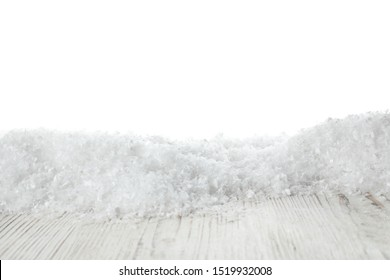 Heap of snow on wooden surface against white background. Christmas season