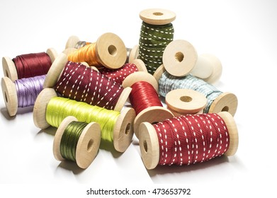 Heap of spools with ribbon