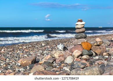 Heap of stones in balance at stony beach of baltic sea (copy space)
