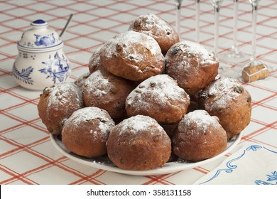 Heap of sugared fried fritters or oliebollen  on a dish