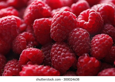 Heap of sweet red raspberries close up