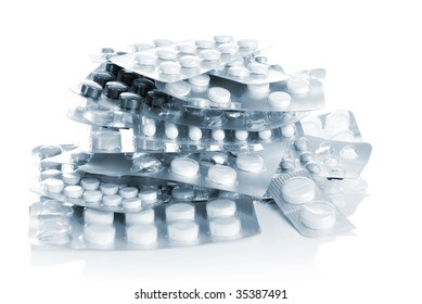 Heap of tablets in standards, isolated on white
