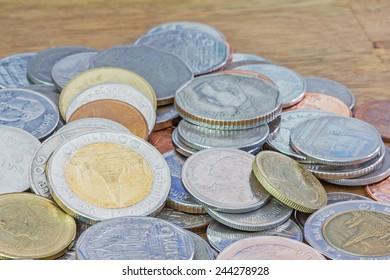 Heap of Thai Baht coins on a wooden table