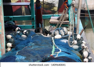 Heap of trawl net or seine in the fishing boat.
