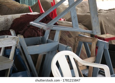 a heap of trestles or saddles, fishingnets and chairs near the coast of El Morche