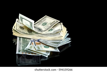 Heap of US money on a black reflective background. Business concept.