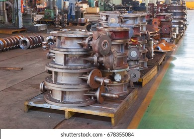 Heap of valve bodies spare parts prapared for mashining in factory. Casting carbon steel boides. Forging stainless still parts. Industrial background from part of valves for power, oil or gas industry