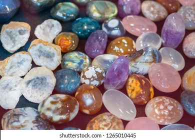Heap of various colored gems. Colorful gemstones. Natural Polished Gemstone Semi Precious Rocks Colorful Background Texture Close Up Phot