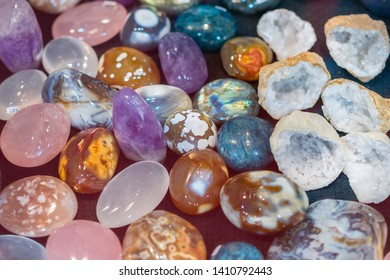 Heap of various colored gems. Colorful gemstones. Natural Polished Gemstone Semi Precious Rocks Colorful Background Texture Close Up Phot. vertical photo