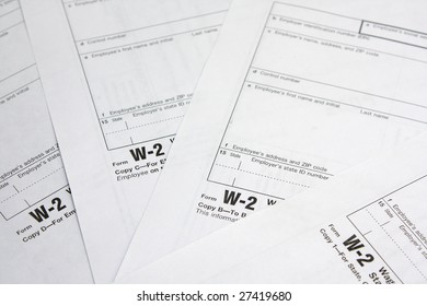 Heap of W-2 tax forms. Business documents.