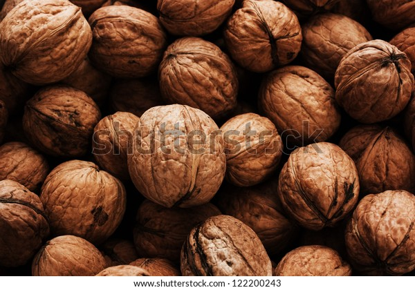 Heap of walnuts with detailed texture.