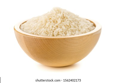 Heap of white uncooked, raw long grain rice in wooden bowl on white background