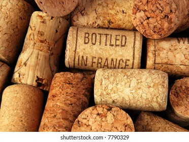 """heap of wine bottle corks, one of them with inscription """"bottled in France"""""""