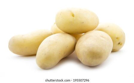 heap of young organic potatoes isolated on white background