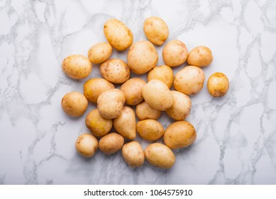 Heap of young unpeeled potatoes, top view