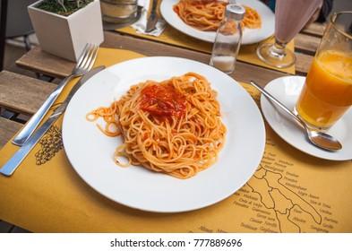 Heaped plate of traditional Italian spaghetti