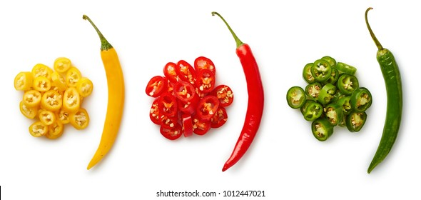 Heaps of colorful (red, yellow, green) chopped chili peppers isolated on white background. Top view