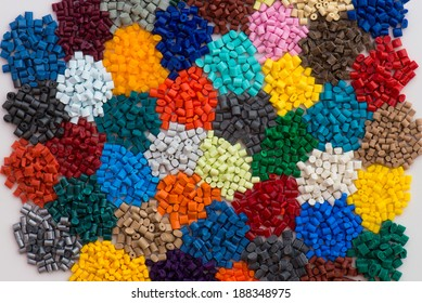 heaps of dyed plastic polymer resin
