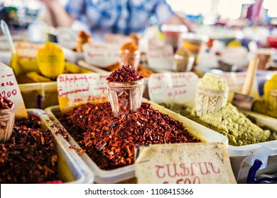 Heaps of spices on the market in Yerevan, Armenia. Tashir traditional market in Armenia. TRANSLATION of writing in Russian and Armenian: Pepper, paprika, coriander, zira, suneli, Armenia