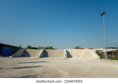Heaps of three types of the sand at the factory that produces the concrete. Storage of granular material outdoors