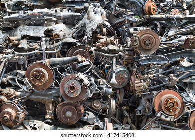 Heaps of used old auto disk and drum brake parts for recycling at workshop