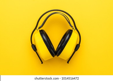 hearing protection industrial ear muffs on yellow background