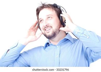 Hearphones on man's head with blue shirt
