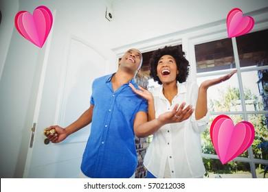 heart against happy couple entering home 3d